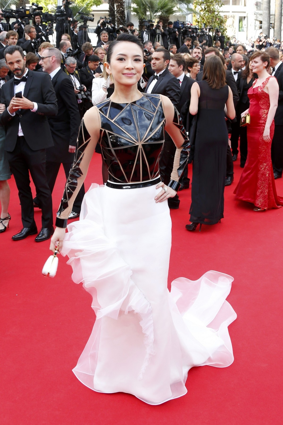 Actress Zhang Ziyi poses on the red carpet as she arrives for the opening ceremony of the 67th Cannes Film Festival in Cannes