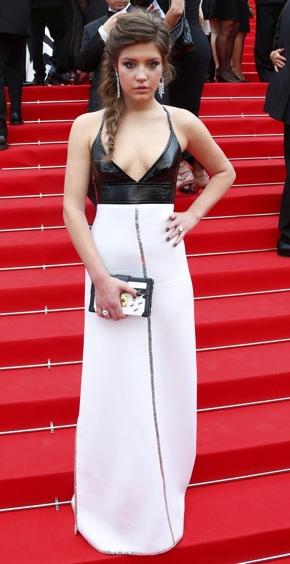 Actress Adele Exarchopoulos poses on the red carpet as she arrives for the opening ceremony of the 67th Cannes Film Festival in Cannes