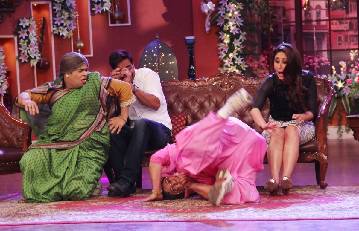 Dadi topples while trying to steal a kiss