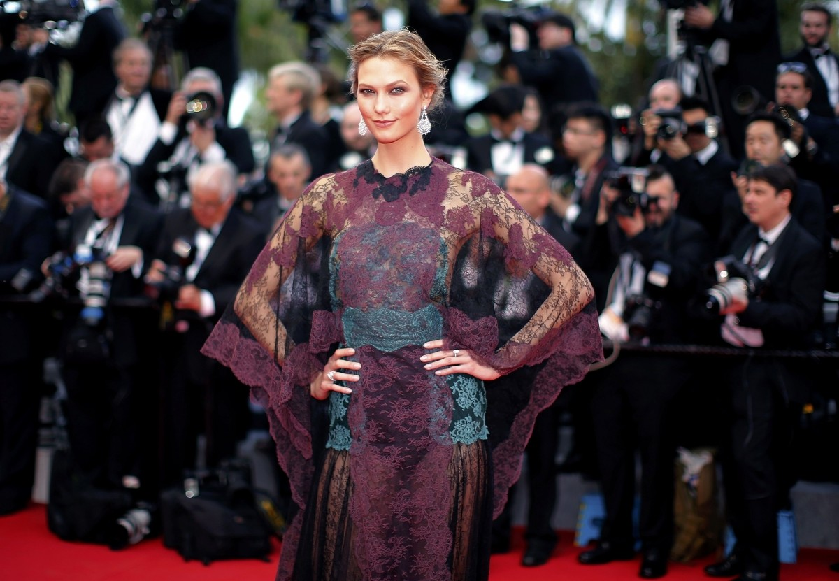 Model Karlie Kloss poses on the red carpet as she arrives for the opening ceremony of the 67th Cannes Film Festival in Cannes