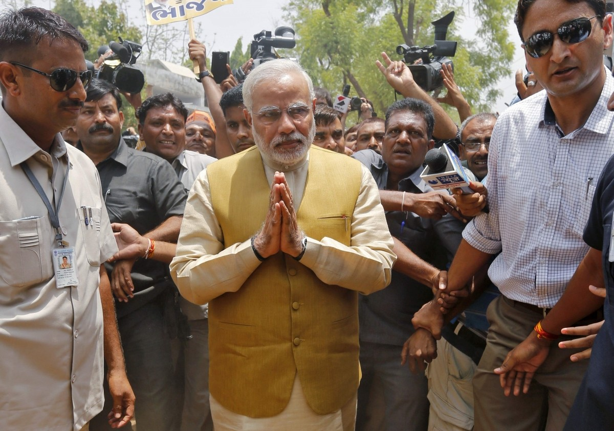 Hindu nationalist Modi, prime ministerial candidate for India's main opposition BJP, gestures as he arrives to seek blessings from his mother Heeraben at her residence in Gandhinagar