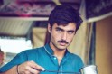 Pakistan's blue-eyed chaiwala, who became an internet sensation, is now a model