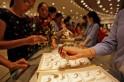 Gold tumbles below Rs 29,000; rupee gains on global cues