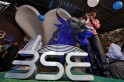 Sensex hits record high; banks rally