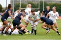 Sarah Hunter reacts to her derriere expose during Women's Rugby World Cup match