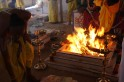 How does burning 50,000 kg of mango wood reduce pollution?