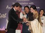 Veteran actress Rekha along with Maharashtra Governor C. Vidyasagar Rao honored Bollywood superstar Shah Rukh Khan with the Yash Chopra Memorial Award..