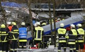 Members of the emergency services work at the site of the two crashed trains near Bad Aibling in southwestern Germany on 9 February 2016. Several people died after two trains collided in the southern German state of Bavaria on Tuesday, a police spokesman said, adding about 100 people were also injured.