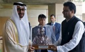 Sheikh Mohammed bin Zayed al-Nahyan (L), Crown Prince of Abu Dhabi and UAE's Deputy Commander-in-Chief of the Armed Forces, receives a bust of Mahatma Gandhi during his visit to Mahatma Gandhi Memorial at Raj Ghat in New Delhi, India.