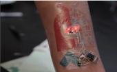 Chaotic Moon high-tech tattoo