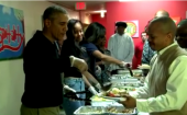 Barack Obama serves Thanksgiving dinner