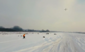 Snowboarders test out being towed by drones