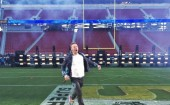 Coldplay's Chris Martin warming up the Levi's stadium  before the Superbowl begins