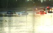 El Nino: Cars stranded on flooded San Diego streets