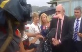 Video shows politician Steven Joyce whacked in the face by pink dildo