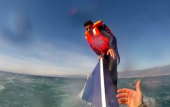 Dramatic video shoes migrant hoisted to safety from sinking boat