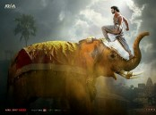 The poster looks striking, with the leading actor, Prabhas' one foot on an elephant's trunk, and the other on its head. The sight is rather glorious and powerful. It is interesting that the makers release the new poster on Maha Shivratri, as Prabhas had been shown as a devotee of Lord Shiva in the prequel, 'Baahubali: The Beginning.' One of the most iconic and loved scenes was when Prabhas shows astounding strength as he carries the Shiv ling on his shoulders. It was one of the most captivating scenes which is still remembered really fondly by the fans.