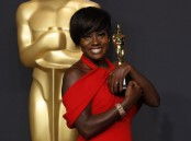 "Actress Viola Davis poses with her Oscar for Best Supporting Actress for the film ""Fences""."