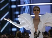 Singer Celine Dion's sleeves on her gown she adorned at the Billboard Music Awards were packed up with tissue paper, according to her stylist Law Roach. Dion, 49, flaunted a floor-length, figure-hugging, white gown with a v-plunge neckline and accentuated shoulder detail to the awards gala on May 21.