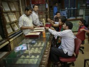 Risk aversion buying pushes gold prices to near Rs 30,000 per 10 gm