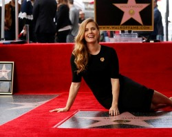 Actor Amy Adams poses on her star after it was unveiled on the Hollywood Walk of Fame in Los Angeles.