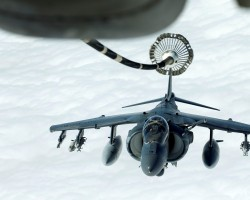 A U.S. Marines Harrier AV-8B makes its way to a fueling boom suspended from a U.S. Air Force KC-10 Extender during mid-air refueling support to Operation Inherent Resolve over Iraq and Syria air space.