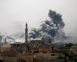 Smoke rises from an airstrike during a battle between Iraqi forces and Islamic State militants in western Mosul.