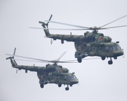 Belarussian Mi-8 helicopters fly in formation during the Zapad-2017 war games.