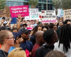 Demonstrators rally before the speech by Richard Spencer.
