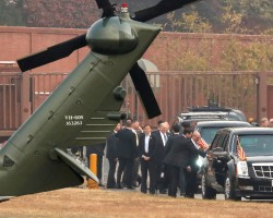 White House senior staff discuss the situation as President Trump sits in his car after being grounded from an attempt to visit the Demilitarized Zone dividing North Korea and South Korea, at a U.S. military post in Seoul. Trump's secret attempt to visit the heavily fortified demilitarized zone was cancelled due to fog and mist.