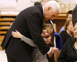 Vice President Mike Pence hugs Evelyn Holcombe at Floresville high school in Floresville, Texas. Holcombe was in the church during the shooting.