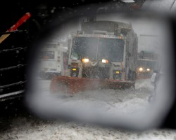 A snowplow is seen in a car's side mirror in upper Manhattan during Storm Grayson in New York City, New York, U.S., January 4, 2018.