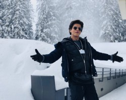 "Superstar Shah Rukh Khan, who is in Davos to receive an honour at the 24th Annual Crystal Awards, recreated his signature open arms pose here in a middle of a snow clad path. Excited to be here, Shah Rukh tweeted an image of himself recreating the iconic pose and captioned it: ""Switzerland main aake yeh na kiya toh kya kiya...?! Loving being at the Davos, now to get ready for the Crystal Award Ceremony. Davos Diaries""."