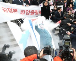 "North Korea on Tuesday criticized the burning of its national flag and photos of its leader Kim Jong-un during a protest rally against its planned participation in the upcoming Winter Olympic Games in South Korea. In an article published by the Korean Central News Agency (KCNA), Pyongyang accused South Korean conservatives of unscrupulously ""letting out reckless remarks chilling the hardly-won atmosphere of improved inter-Korean relations""."