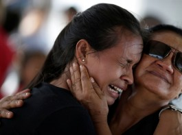 A woman is seen crying after receiving the information that her brother was one of the inmates who died during a prison riot, in front of the Medical Legal Institute in Manaus, Brazil, January 3, 2017.