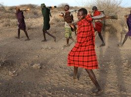 Turkana tribesmen walk with guns in order to protect their cattle from rival Pokot and Samburu tribesmen near Baragoy, Kenya. Armed cattle herders have been flooding onto farms and wildlife conservancies in drought-ravaged northern Kenya, leading to violence in which at least 11 people have been killed and a tourist lodge torched, residents said.