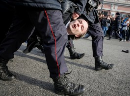 Law enforcement officers detains an opposition supporter during a rally in Moscow.