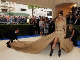 Bollywood actress Priyanka Chopra looked stunning in a Trench Coat dress with longest train ever 2017 Met Gala Red Carpet.
