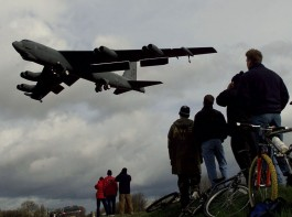 A B-52 bomber is watched by a group of curious onlookers as it lands at RAF Fairford, February 21, 1999. The B52s arrived from the U.S.A. as part of NATO's preparations for air attacks on Yugoslavia as tensions in the Kosovo crisis increased.