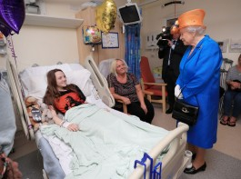 Queen Elizabeth speaks to Millie Robson, 15, from Co Durham, and her mother, Marie.