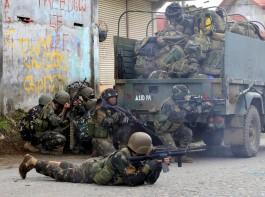 Government troops are seen during an assault on insurgents from the so-called Maute group, who have taken over large parts of Marawi City in southern Philippines.