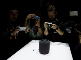 Members of the media photograph a prototype Apple HomePod during the annual Apple Worldwide Developer Conference (WWDC) in San Jose, California. Apple introduced the HomePod, a voice-controlled speaker that can make music suggestions and adjust home temperatures, taking aim at Amazon.com's Alexa feature and Echo devices.