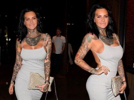 Jemma Lucy flaunts her ample assets in grey dress.
