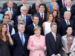 Participants of the G20 summit and their spouses pose for a family photo aroung German Chancellor Angela Merkel (2ndL) and her husband Joachim Sauer (3rdR) at the Elbphilharmonie before attending a concert in Hamburg. First row from L to R: wife of the Argentinia's President Juliana Awada, Argentinia's President Mauricio Macri, wife of China's President Peng Liyuan and China's President Xi Jinping. Second row from L to R: Indonesia's President Joko Widodo, French President's wife Brigitte Macron, French President Emmanuel Macron, US First Lady Melania Trump, US President Donald Trump and India's Prime Minister Narendra Modi.