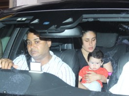 Taimur is happily sitting like a boss in mother Kareena Kapoor Khan's lap.