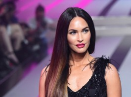 American actress Megan Denise Fox dazzles in a semi-sheer feathered gown at the Fashion Fest AW17 show in Mexico.