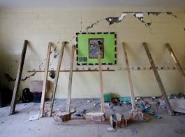 Support beams are placed on a crumbling wall of a room during the search for students at the Enrique Rebsamen school after an earthquake in Mexico City, Mexico, September 21, 2017.