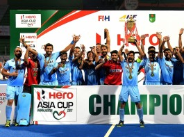 Team members of India celebrate with the trophy after the awarding ceremony for Asia Cup Hockey 2017 in Dhaka, Bangladesh, on Oct. 22, 2017. India clinched the title for the third time by defeating Malaysia with 2-1 in the final.