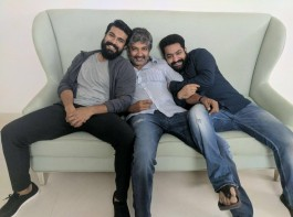 Pic of the day!!! SS Rajamouli is seen seated on a white sofa, with actors Mega Powerstar Ram Charan and Young Tiger Jr NTR sitting on either side of him.