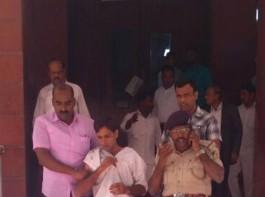 The man who stabbed Karnataka Lokayukta Justice P. Vishwanath Shetty at his office, being taken away by police in Bengaluru on March 7, 2018.